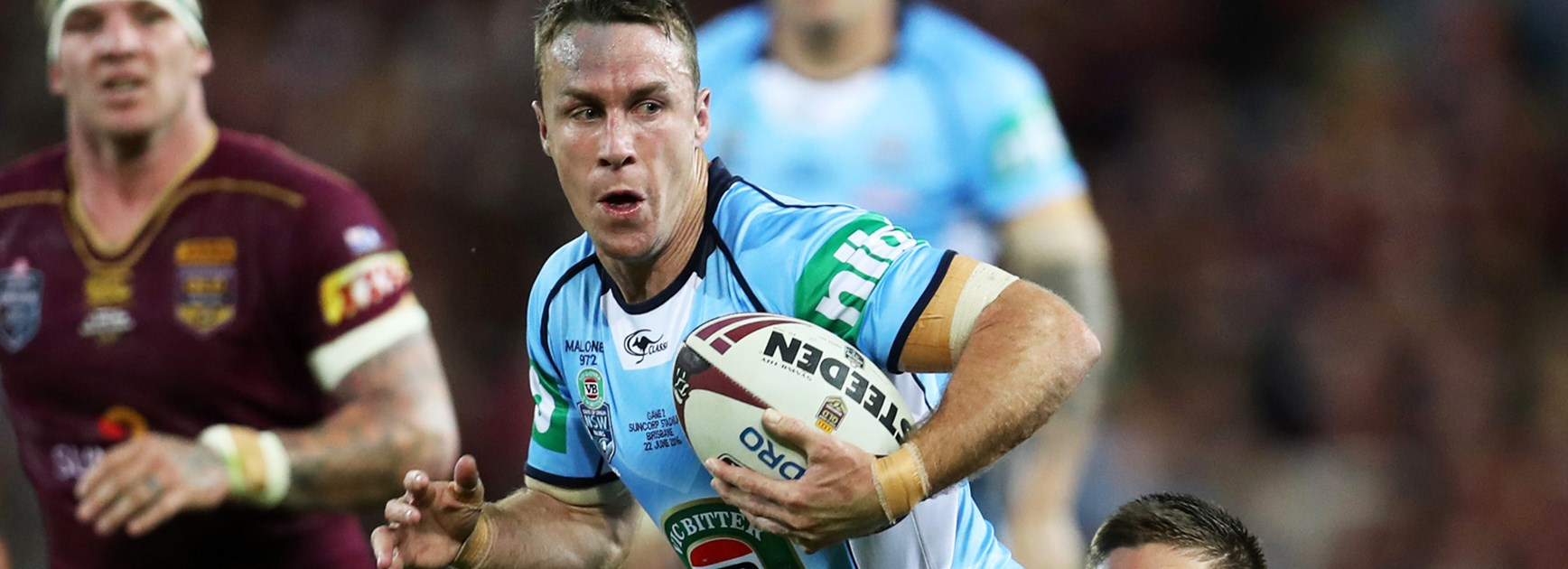 NSW five-eighth James Maloney is wrapped up by the Queensland defence during Origin II.