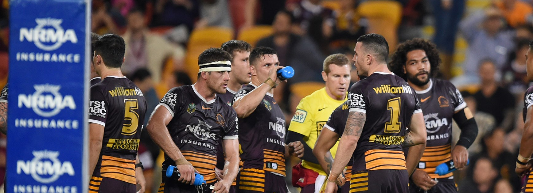 The Broncos look on after another Panthers try in the first half at Suncorp Stadium.