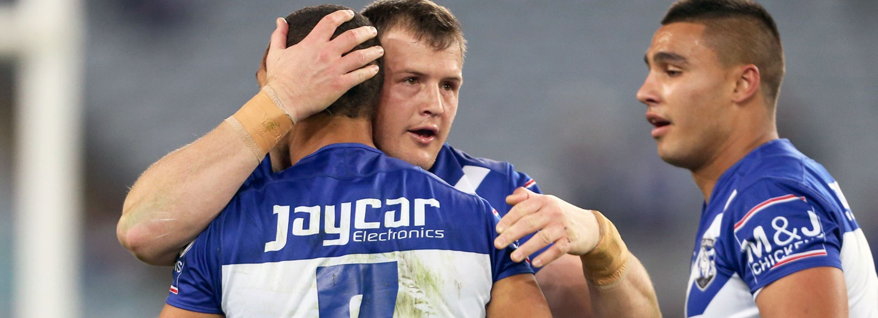 Bulldogs players celebrate against the Dragons in Round 21.