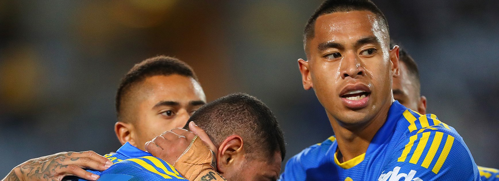 The Eels celebrate a try against the Wests Tigers at ANZ Stadium.
