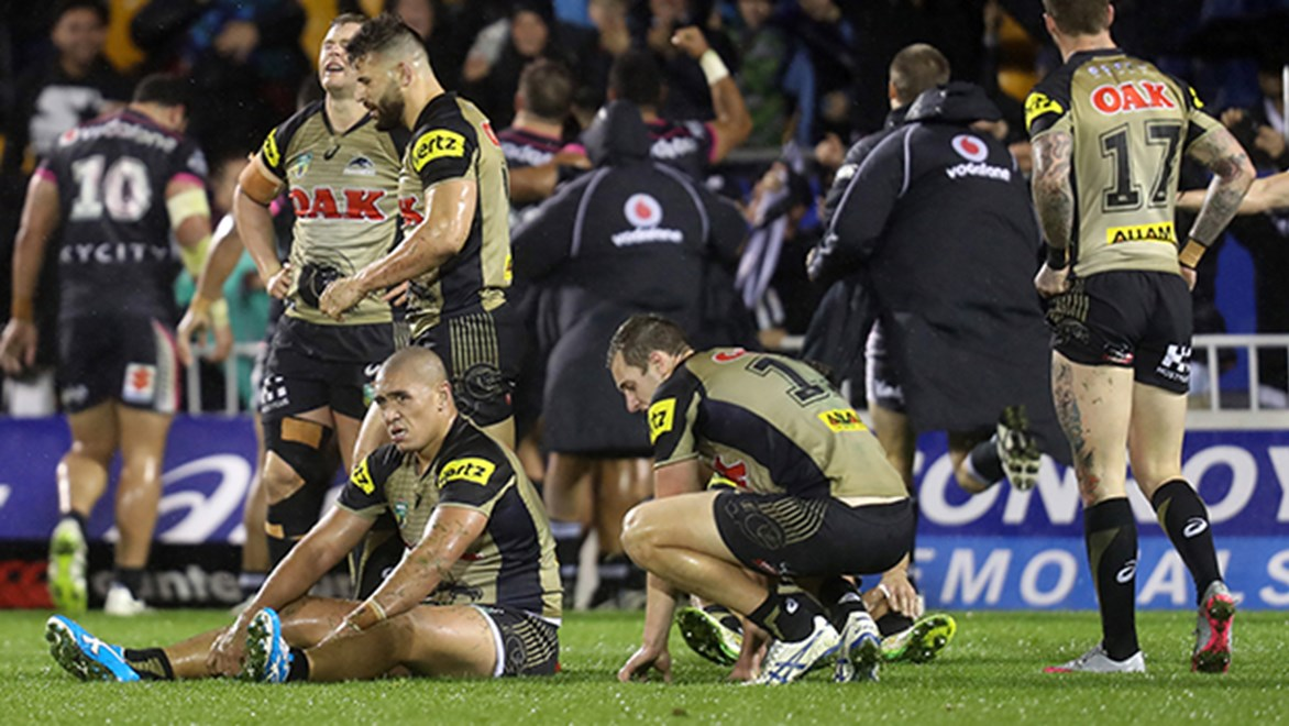 The Penrith Panthers react to Shaun Johnson's golden-point try in Auckland.