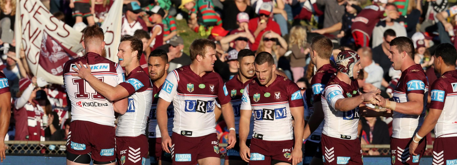 Manly celebrate a try against the Knights at Brookvale Oval in Round 21.