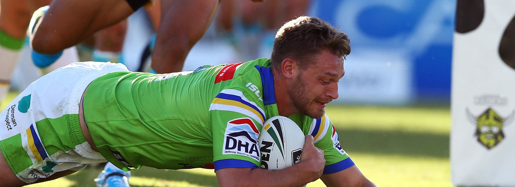 Raiders forward Elliot Whitehead scores for Canberra against the Titans on Saturday.