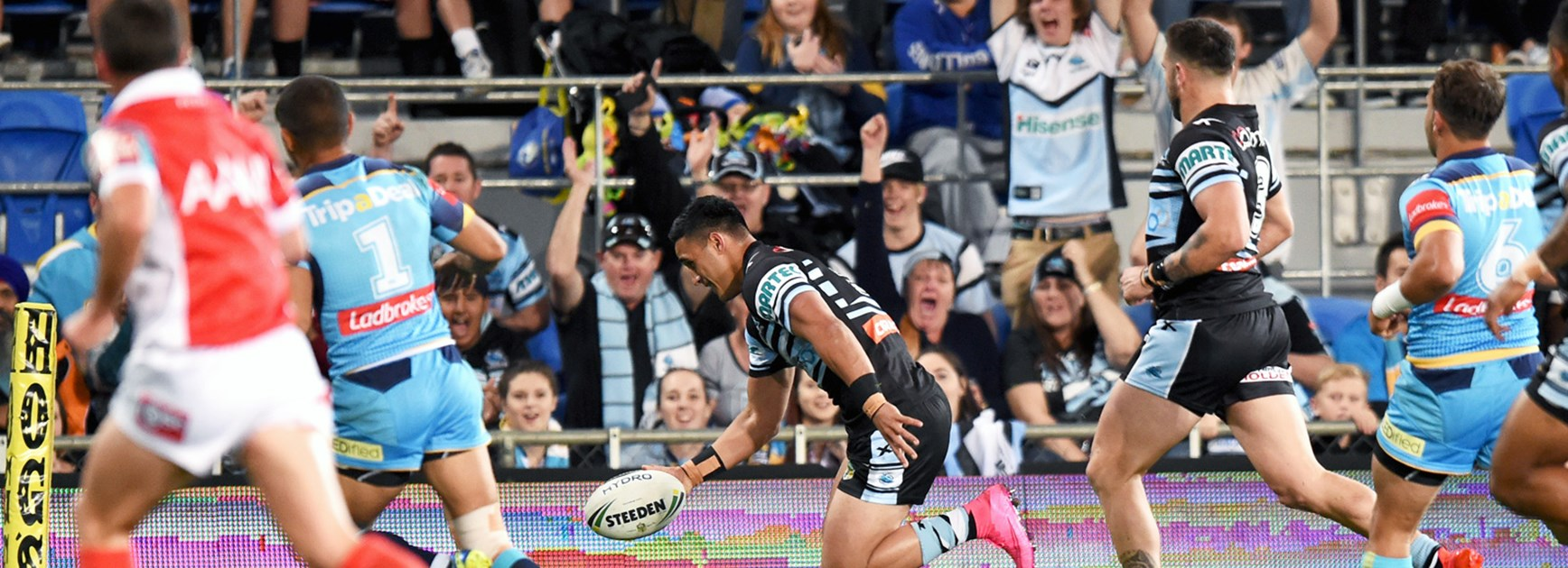 valentine Holmes scores for Cronulla against the Titans on Monday night.
