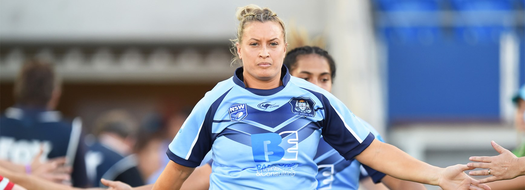 Ruan Sims leads out the women's NSW team to face Queensland last week.