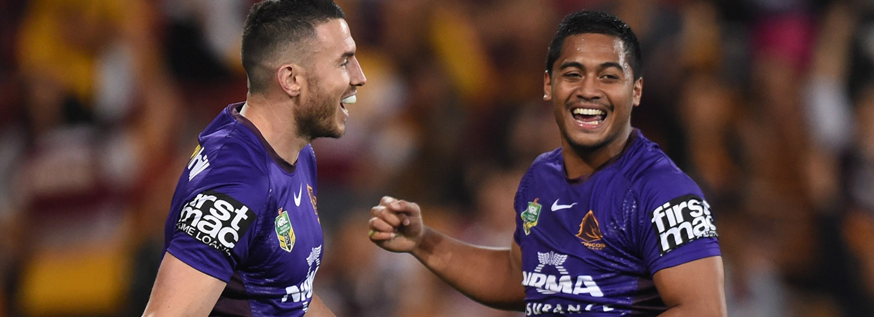 Anthony Milford and Darius Boyd celebrate during the Broncos win over the Eels.