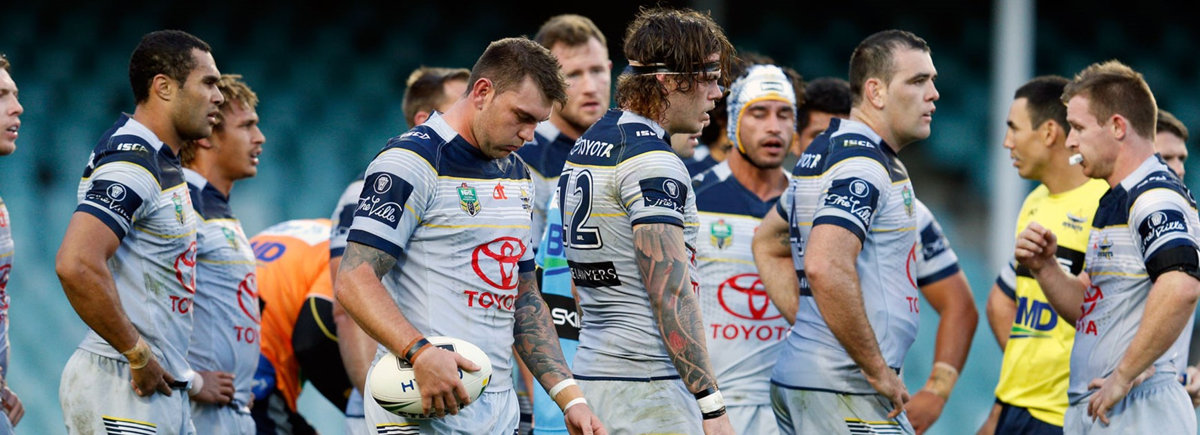 Cowboys players look on dejected against the Roosters in Round 23.