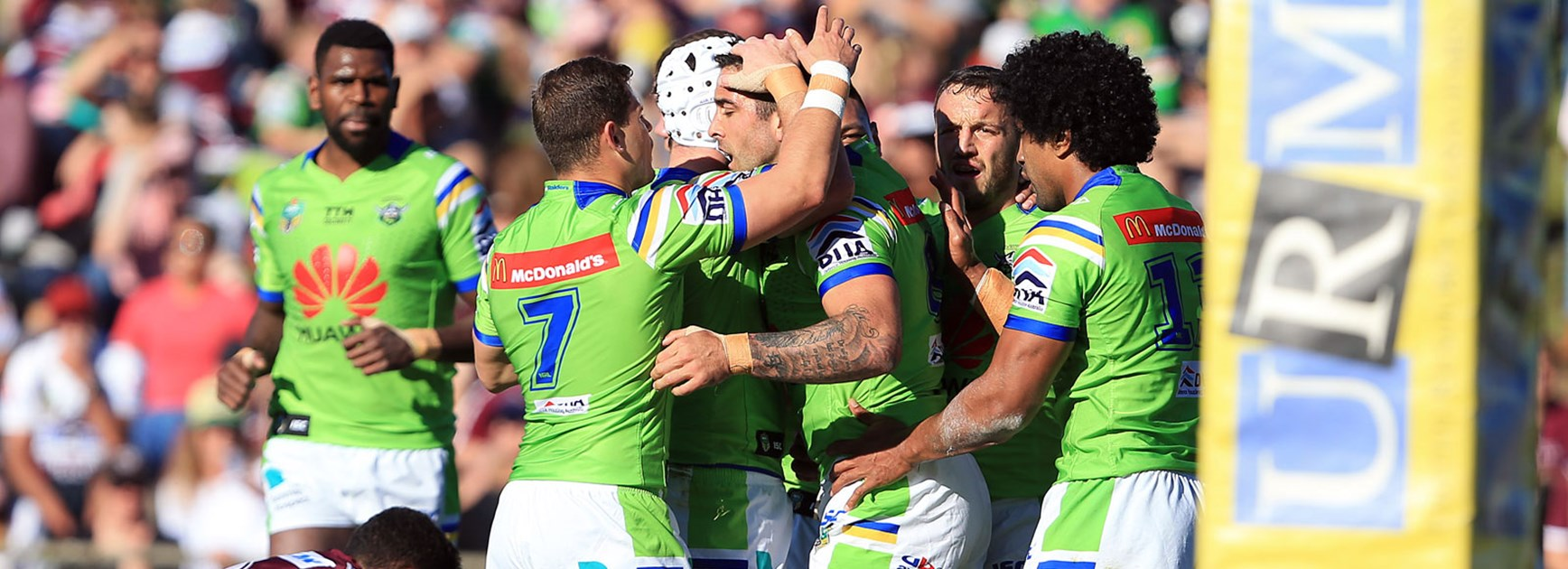 Raiders players celebrate during their win over the Sea Eagles in Round 25.
