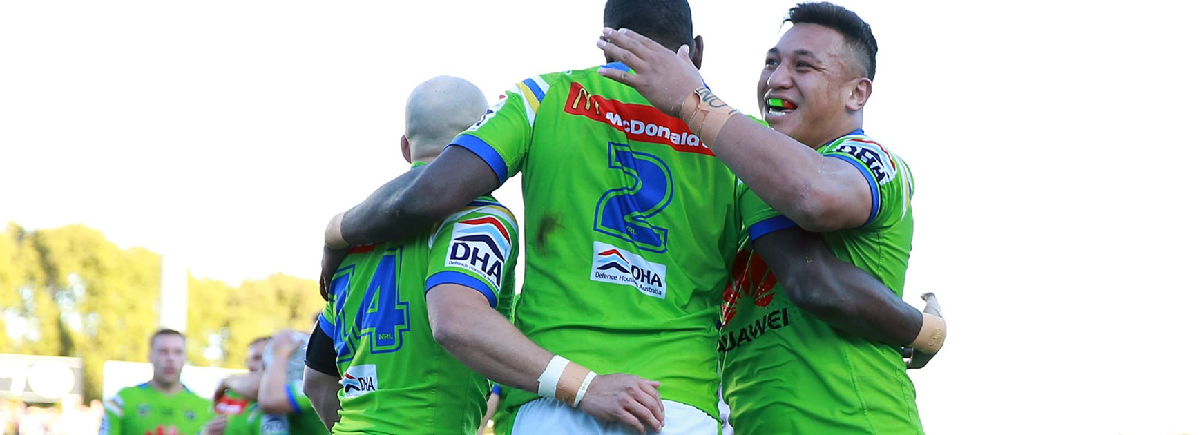 Raiders players celebrate against the Sea Eagles.