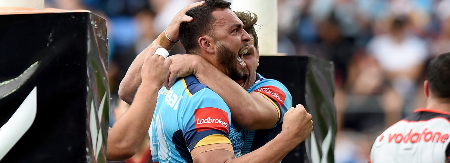 The Titans celebrate a try to Ryan James.