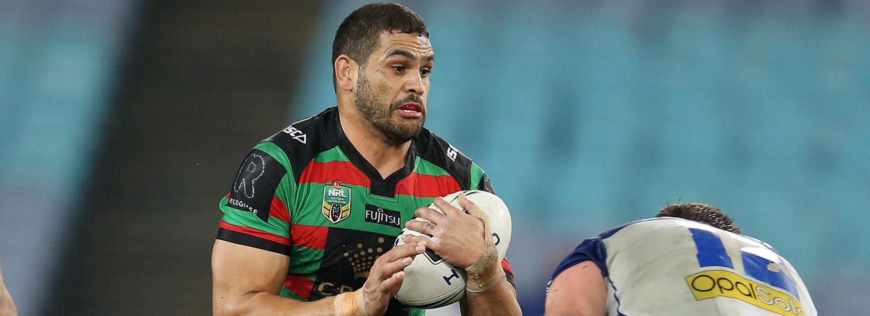 Greg Inglis takes a run against the Bulldogs.