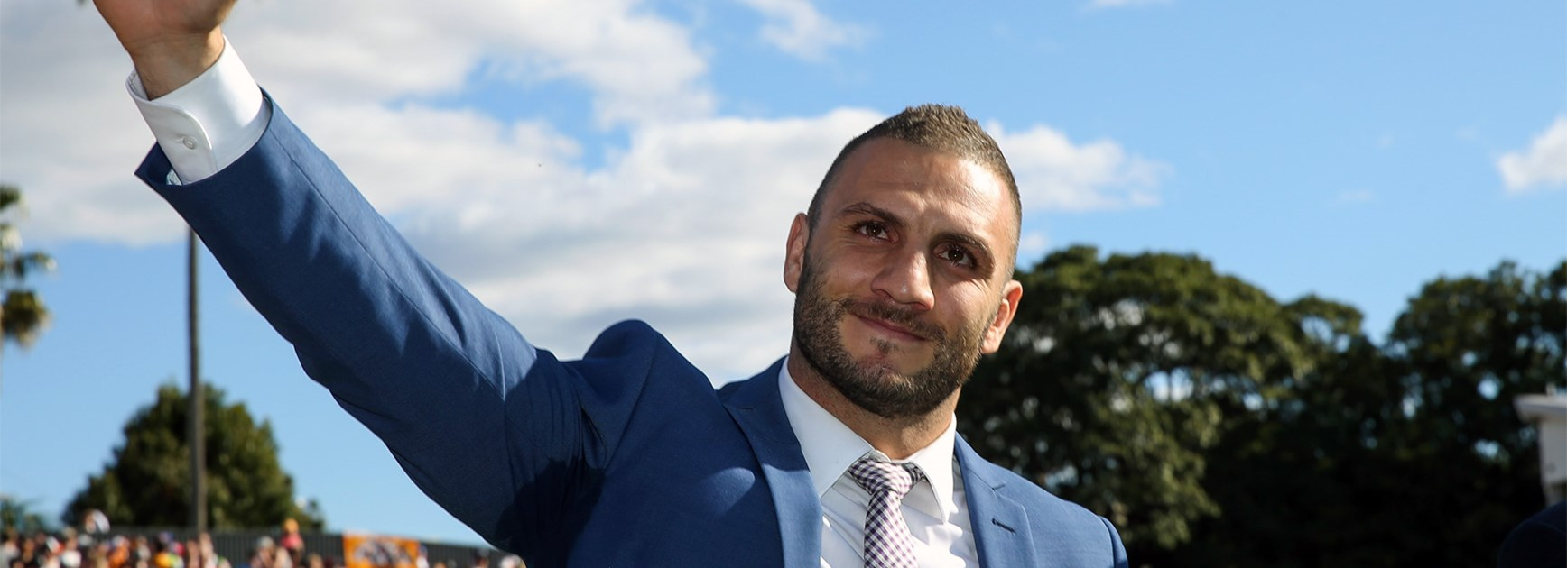 Robbie Farah waves to the crowd at half-time of the Tigers' final game of the 2016 season.