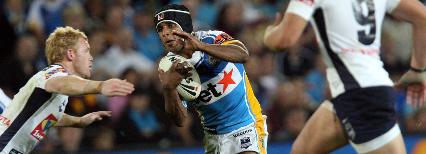 Preston Campbell takes on the Broncos defence in the 2009 Finals series.
