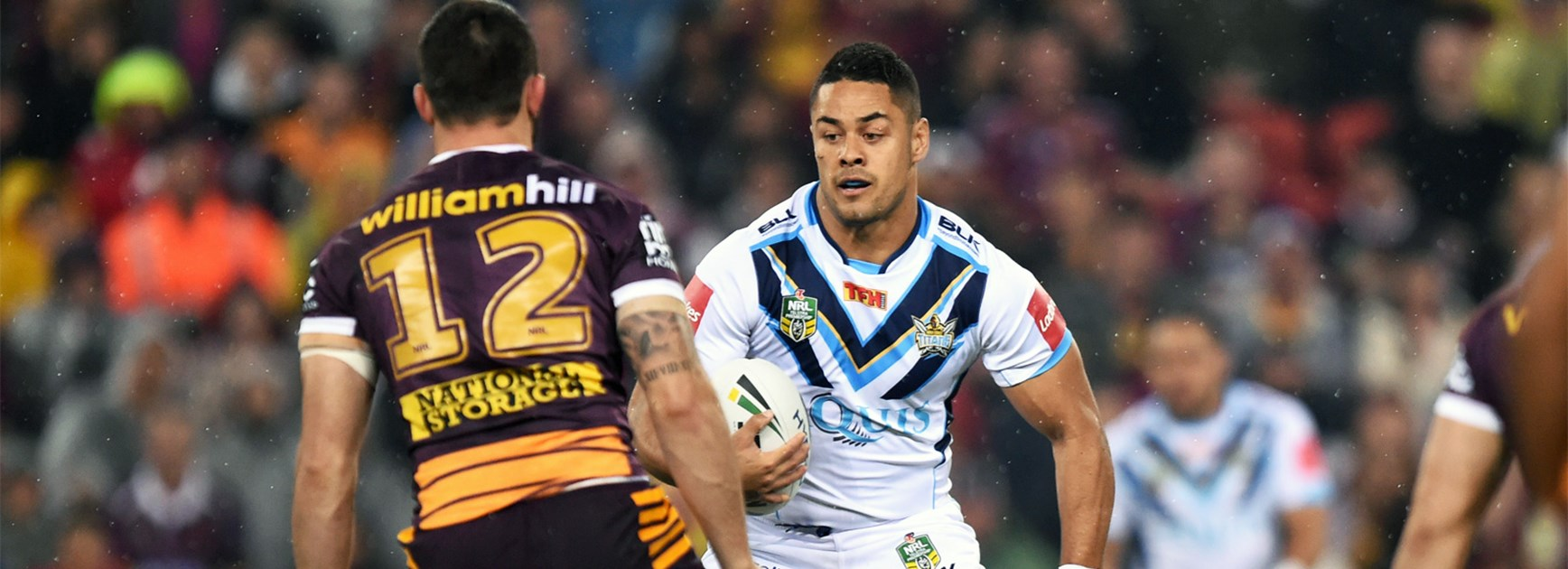 Jarryd Hayne takes on the Broncos defence on Friday night.