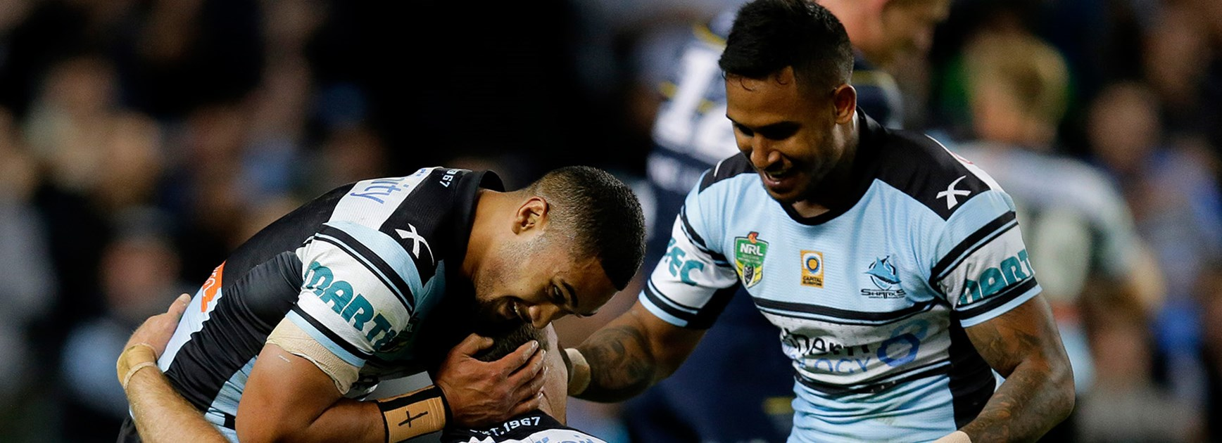 Sharks celebrate another try during the preliminary final against the Cowboys.