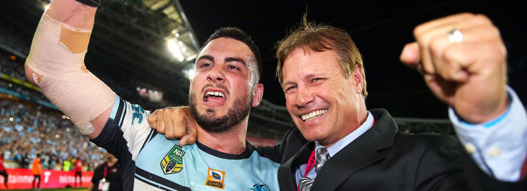 Sharks centre Jack Bird with club legend Andrew Ettingshausen following the grand final.