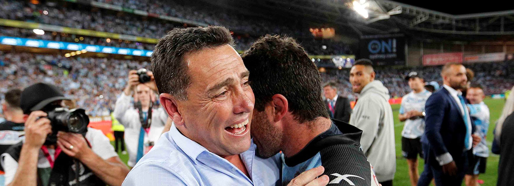 Cronulla Sharks coach Shane Flanagan embraces Michael Ennis after their grand final win.