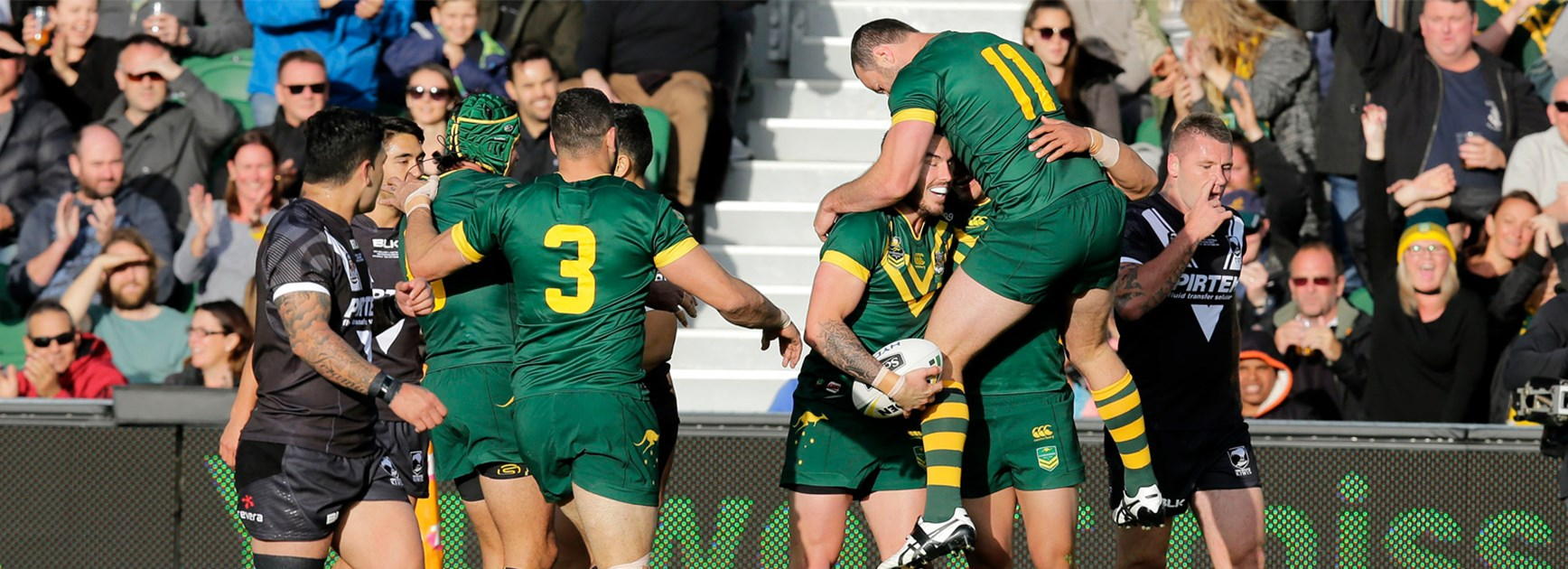 The Kangaroos celebrate Darius Boyd's opening try against New Zealand on Saturday.
