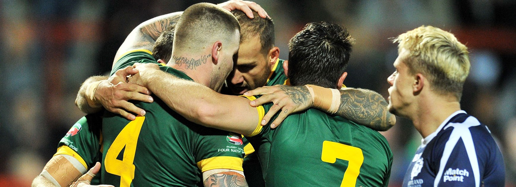 Kangaroos players celebrate during their big win over the Bravehearts to open the 2016 Four Nations.