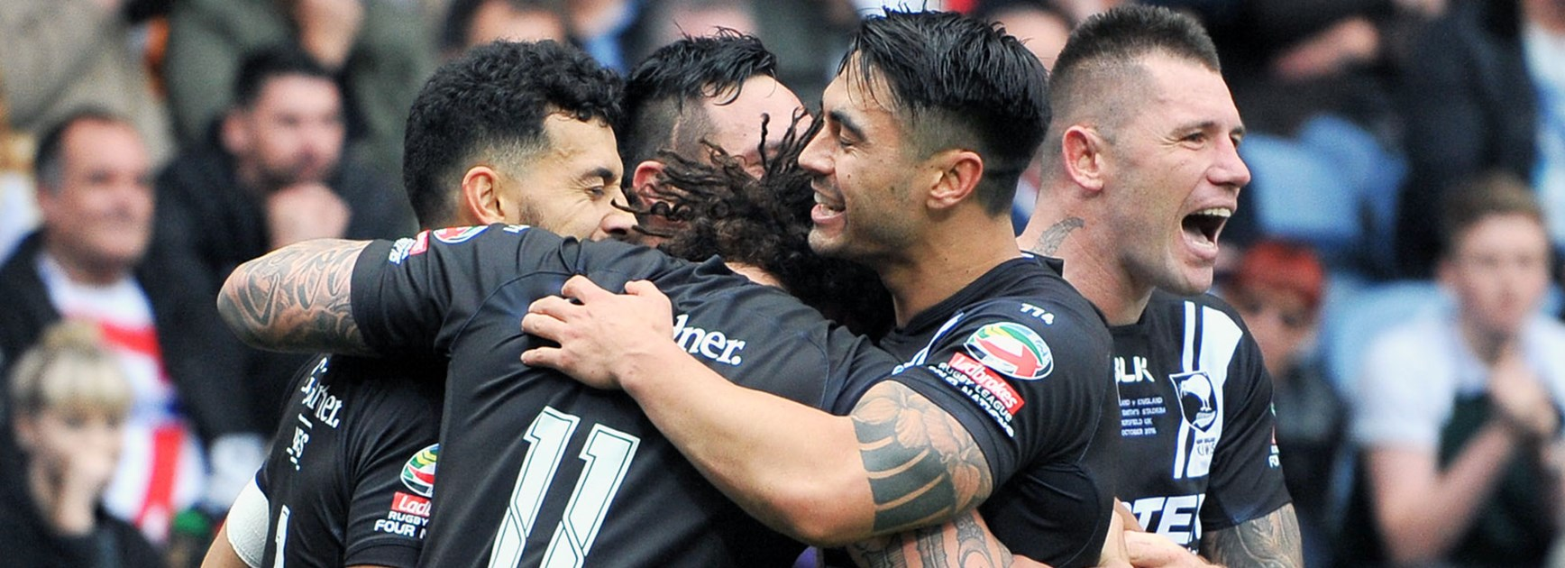 Kiwis players celebrate against England during their Four Nations clash.