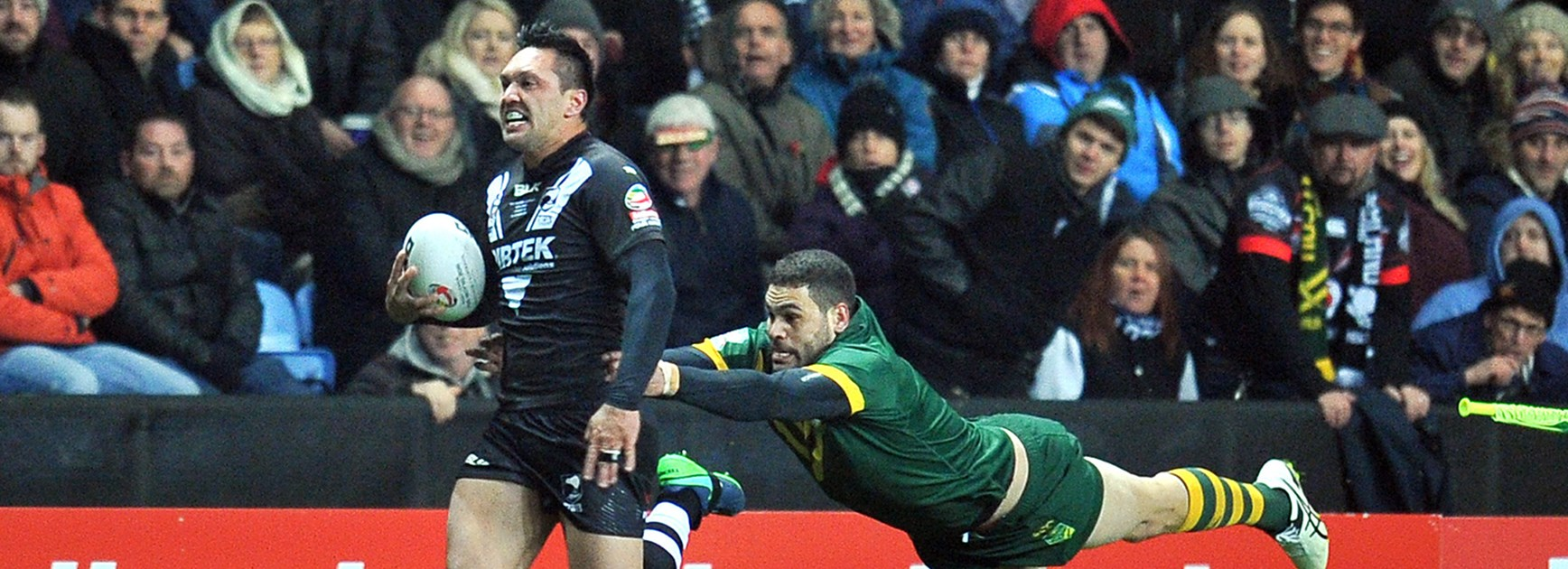 New Zealand's Jordan Rapana is chased down by Australia's Greg Inglis in the Four Nations in Coventry.