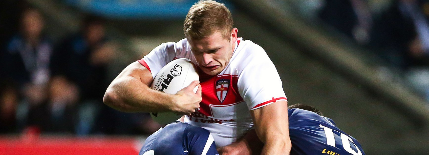 England prop George Burgess crashes into the Scotland defence.