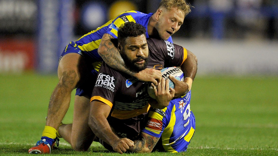 Sam Thaiday is tackled by the Warrington Wolves.