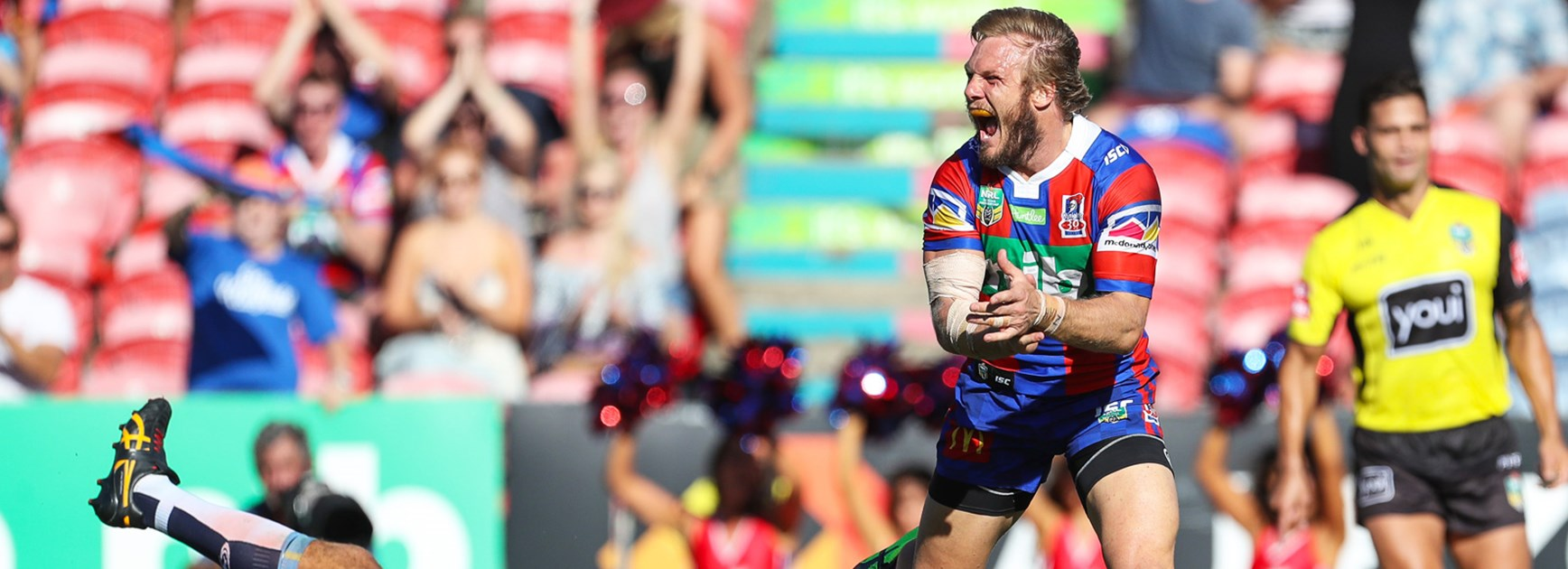 Nathan Ross celebrates a try in the Knights' Round 2 win over the Titans.