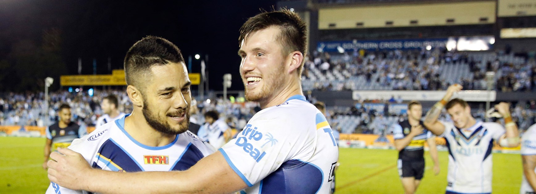 Joe Greenwood celebrates the Titans shock win over the Sharks with Jarryd Hayne.