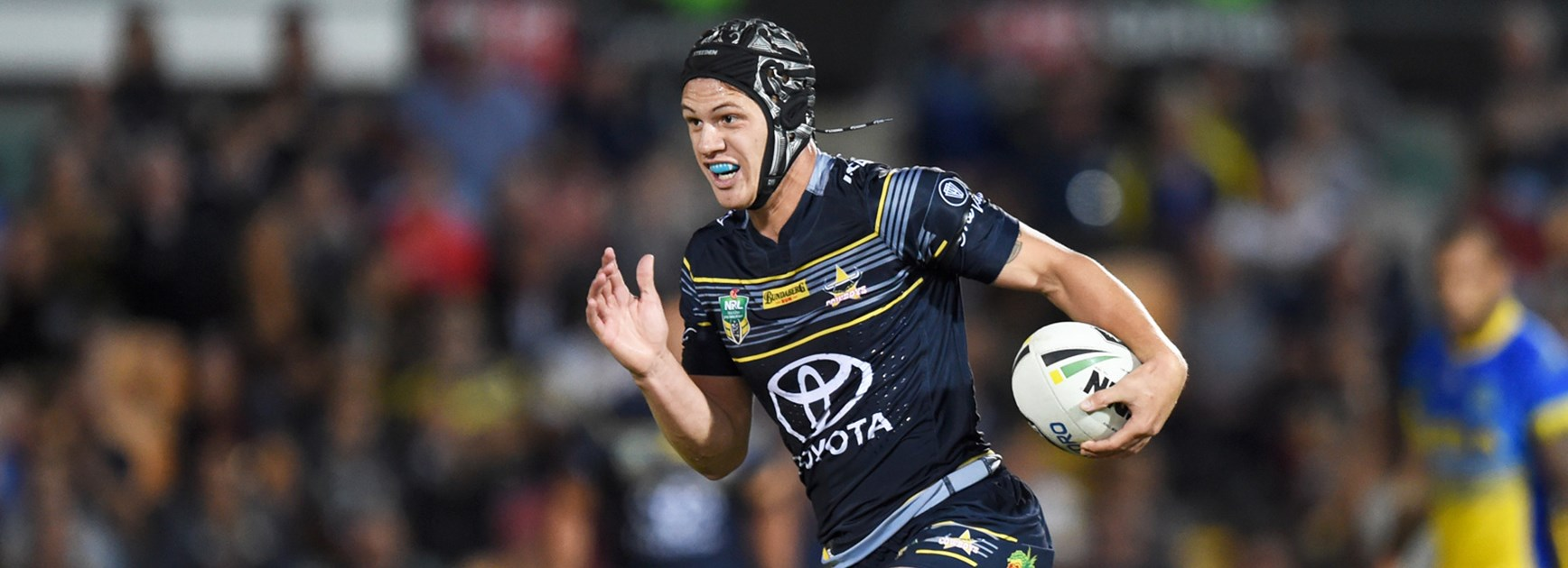 Kalyn Ponga makes a break for the Cowboys against the Eels in Round 9.