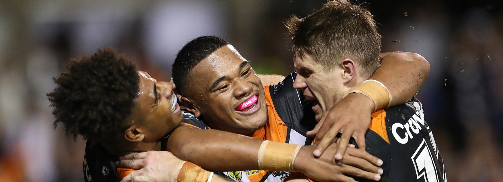 The Wests Tigers celebrate Moses Suli's first-half try against the Sharks.