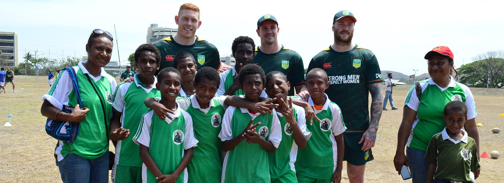 Players from the Australian PM's XIII with PNG school children at a League Bilong Laif holiday clinic.