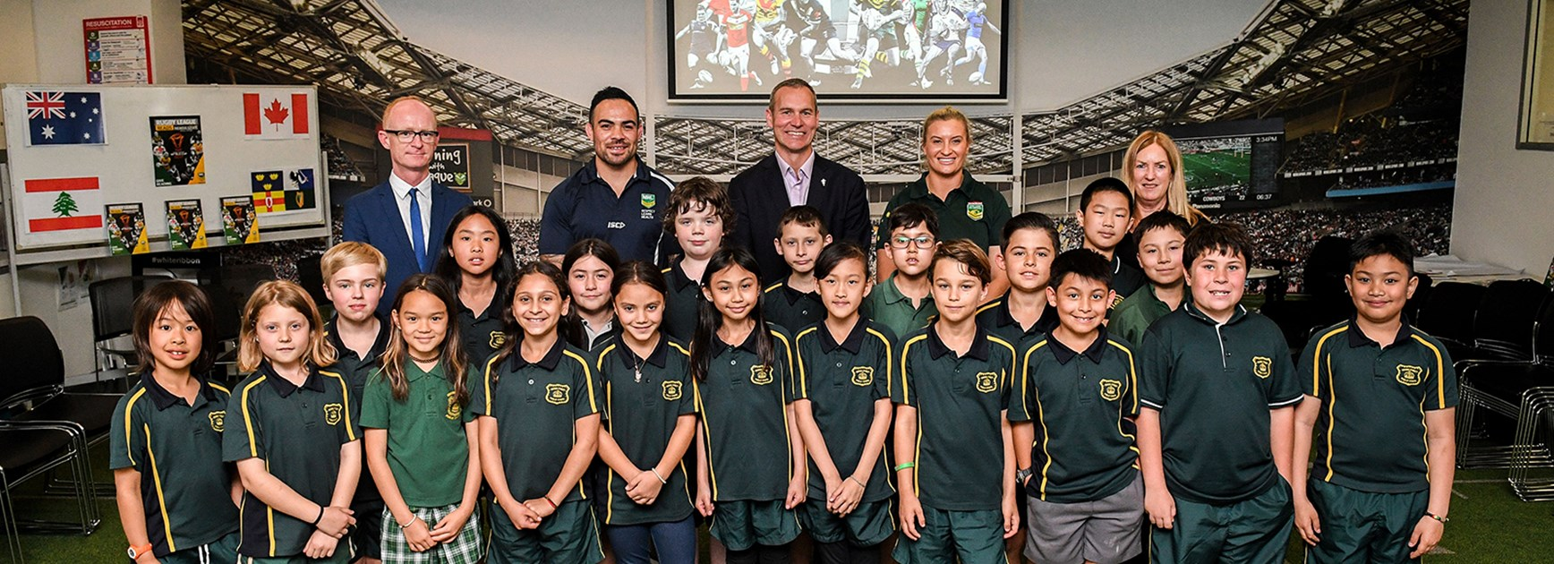 Ruan Sims, Dene Halatau and Andrew Hill join children from Crown Street Public School at Rugby League Central.