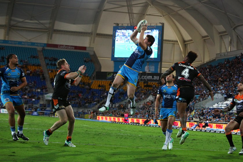 Gold Coast Titans winger Anthony Don leaps high.