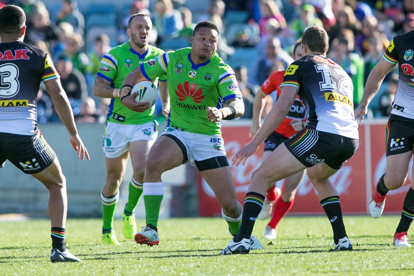 Canberra Raiders centre Joey Leilua takes on the Panthers defence.