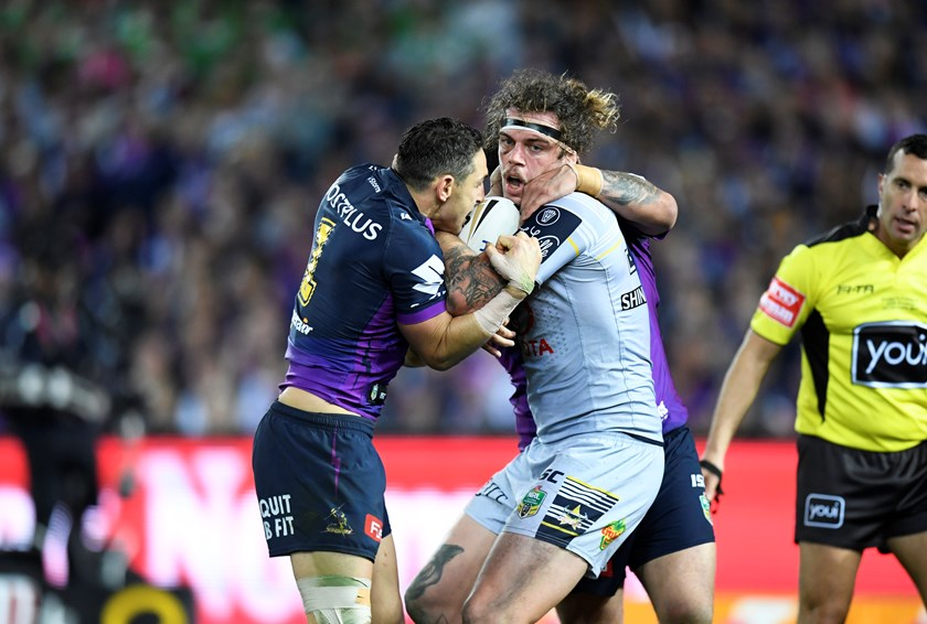 Cowboys back-rower Ethan Lowe takes on the Storm defence.