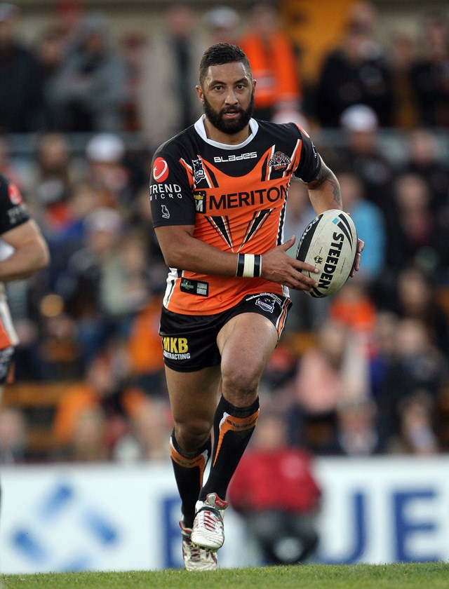 Benji Marshall makes a break for the Wests Tigers in 2013.