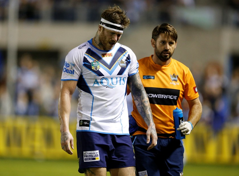 Chris McQueen is forced off due to injury while playing for the Gold Coast Titans.