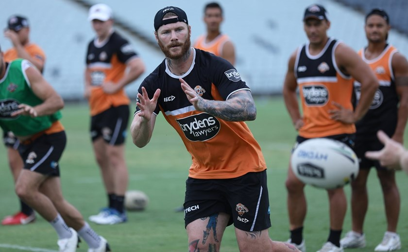Wests Tigers forward Chris McQueen goes through his paces at training.