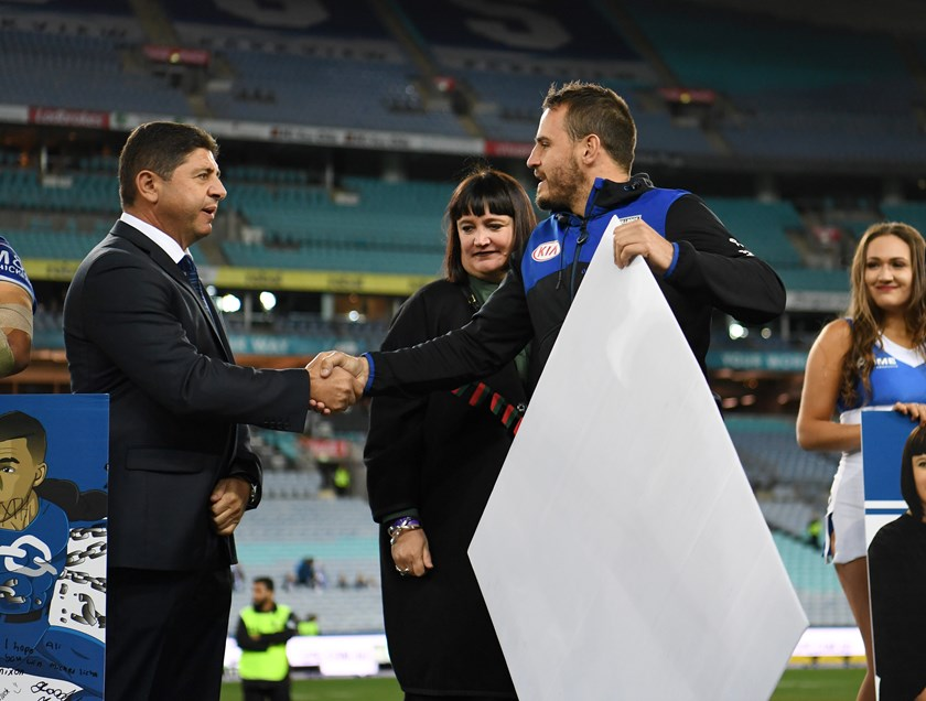 Canterbury chairman Ray Dib with CEO Ralene Castle and Josh Reynolds at a farewell presentation for the outgoing Bulldogs five-eighth last season.