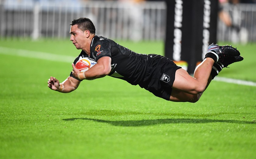 Kodi Nikorima scores for New Zealand at the 2017 World Cup.