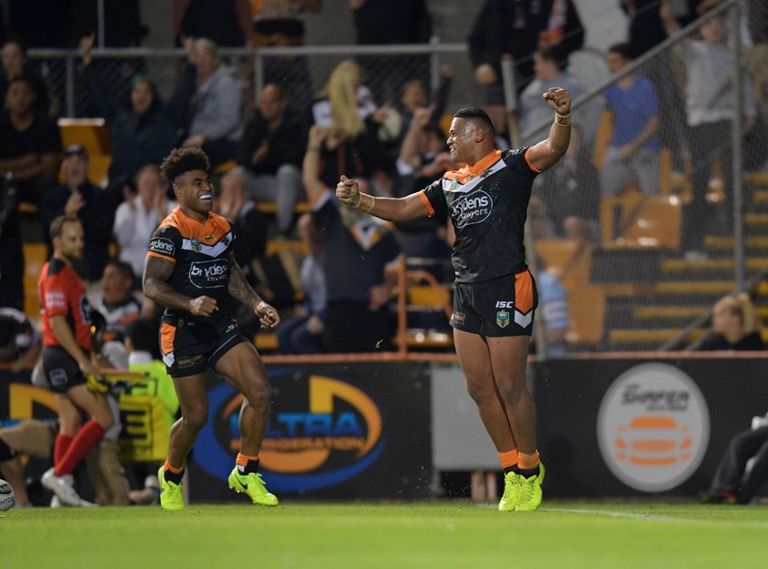 Moses Suli celebrates a try for the Wests Tigers in 2017.