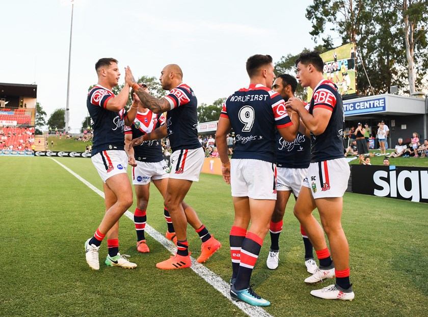 The Roosters celebrate a try against Penrith.