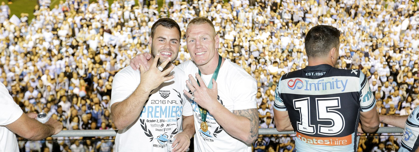 Wade Graham and Luke Lewis after the 2016 NRL grand final.