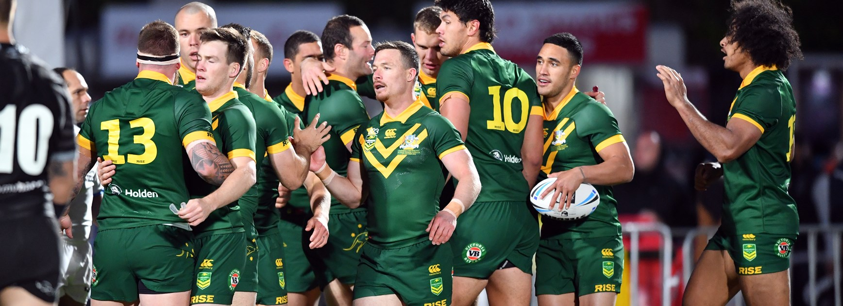 The Kangaroos celebrate a try.