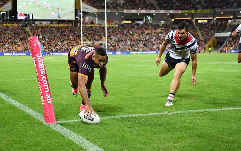 Jamayne Isaako scores a try for the Broncos.