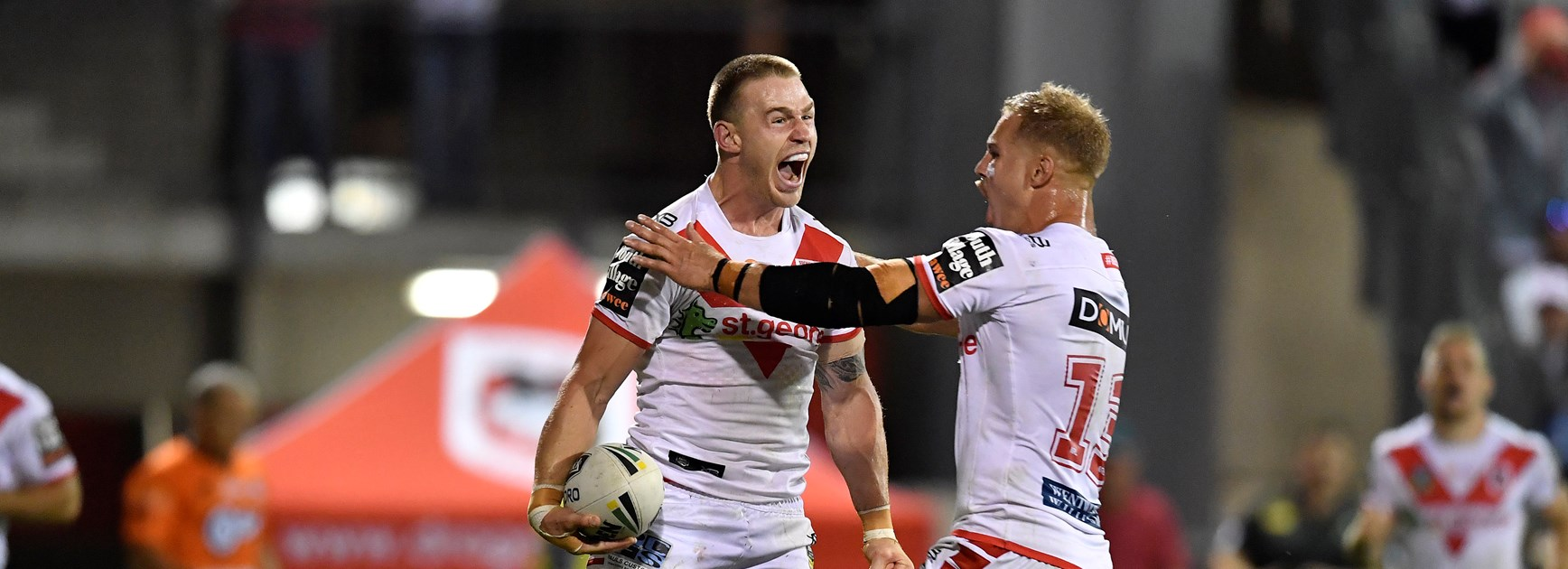 Euan Aitken celebrates a try with Jack de Belin.