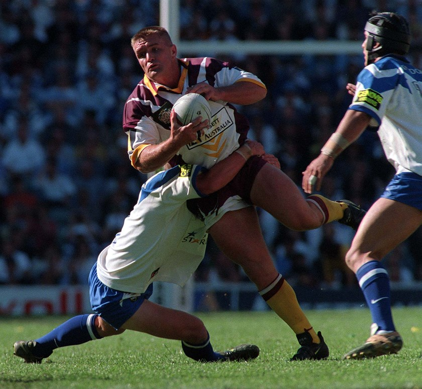 Shane Webcke takes a hit-up for the Broncos in the 1998 grand final win.