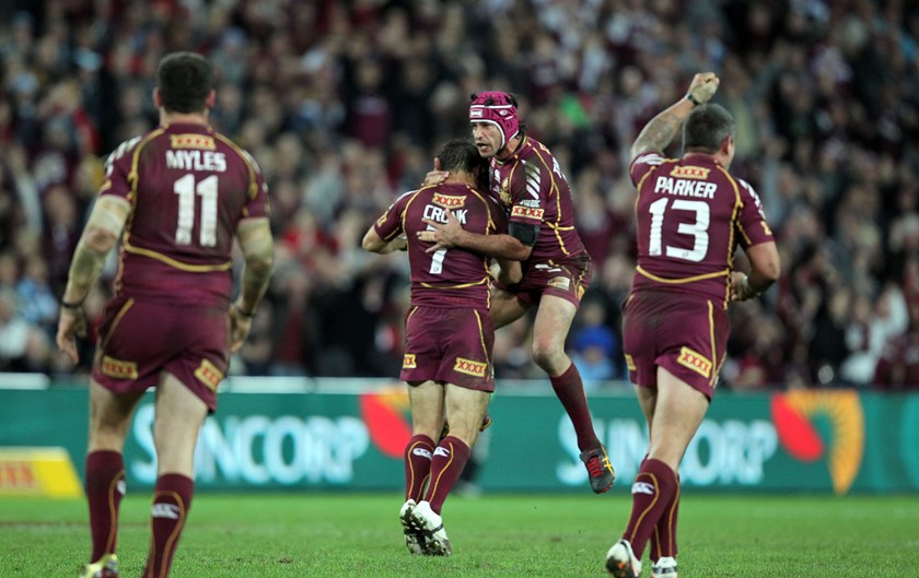 Cooper Cronk gets a hug from Johnathan Thurston after a match-winning field goal for the Maroons in 2012.