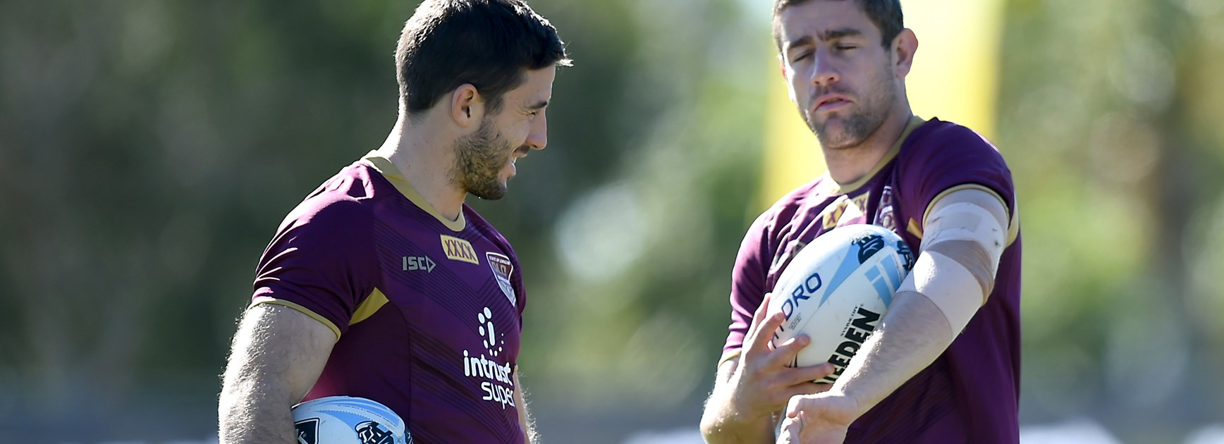 Queensland Maroons Ben Hunt and Andrew McCullough.
